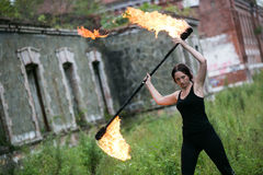 Fire show girl with flaming torches Stock Images