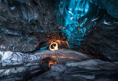 Fire show in the ice cave, Iceland Stock Photos