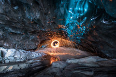 Fire show in the ice cave, Iceland Stock Photography