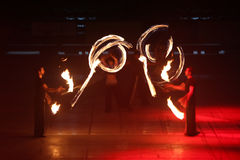 Fire Show. ISTANBUL, TURKEY - JANUARY 31, 2015: People performs fire show during Monster Hot Wheels in Sinan Erdem Dome Royalty Free Stock Photos