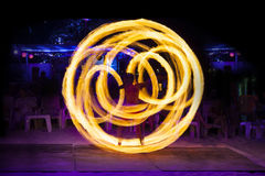 Fire show at Ko Phi Phi Don, Krabi, Thailand. Fire performance, A fire twirler with staff Stock Photography