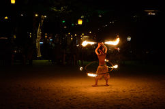 Fire show. KOH SAMET, THAILAND - DEC 26, 2011 : Young boy dans during  the night fire show on a beach. One from most popular tourist attraction in the Samet Stock Images