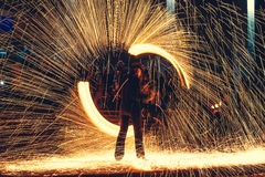 Fire show a lot of sparks in the night Royalty Free Stock Photos
