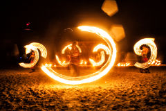 Fire show. Managing people with fire, creating a beautiful shape Royalty Free Stock Images