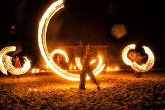 Fire show. Managing people with fire, creating a beautiful shape Royalty Free Stock Image