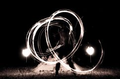 Fire show. The men rotating fire balls Stock Photo