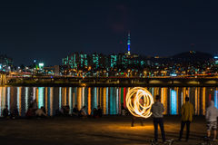 Fire show near the river, backgrond with Seoul city Royalty Free Stock Image