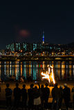 Fire show near the river, backgrond with Seoul city. Fire show was presented near the Banpo bridge, Han river, Seoul, South Korea. The background view is the Stock Photo