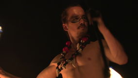 Fire show performance. Handsome male fire juggler performing contact manipulation with twofire torchs stock footage