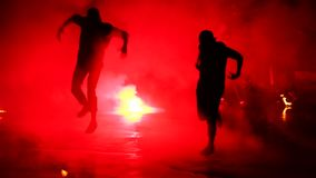 Fire show performance at night. Fire-show silhouette of danser man dancing with fire. Two actors, professional artists. Showing performing beautiful fire stock video footage