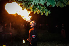 The fire show performed by Belarusian folk ensemble. Stock Photos