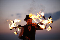 Fire show tricks, keeping balance Royalty Free Stock Photos