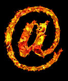 Fire at-sign. Fire letter at-sign on black background Royalty Free Stock Images