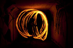 Fire Sihouette. Dansing with fire at night Stock Photo
