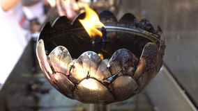 Fire in the silver oil lamp for worship Buddha at Wat Phra That Doi Suthep is most popular and place famous stock video footage