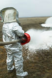 Fire in a silver protective suit. Stock Image