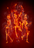 Fire skeletons. Dancing fiery skeletons. Halloween party Royalty Free Stock Image