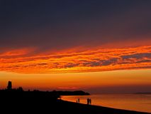 Fire In The Sky. A dark orange sunset over Lake Michigan in the summertime Royalty Free Stock Images