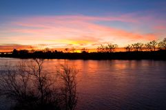 Fire in the sky. Colorful sky reflection in the river at sunset Stock Images