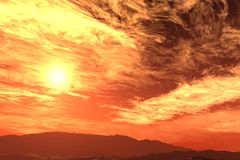 Fire Sky. The sun is low in the sky over the desert with sky lit up with red Royalty Free Stock Photos