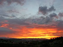 Fire in the sky over the city and mountais - unretouched Royalty Free Stock Photos