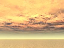 Fire in the sky over open sea. Sunset lighting up the skies like fire Royalty Free Stock Photos