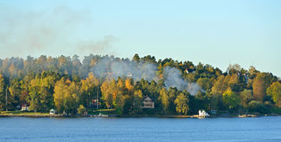 Fire on small island in Baltic Sea. Sweden Royalty Free Stock Images