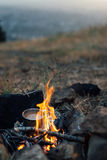 Fire with  small pot of food Royalty Free Stock Images