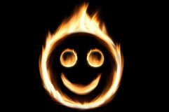 Fire smiley. Fire flames in shape of a smiling face Royalty Free Stock Image