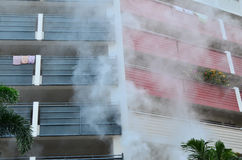 Fire and smoke. Apartment building on fire and smoke Stock Photo