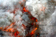 Fire and smoke. Fire under the heavy smoke Royalty Free Stock Image