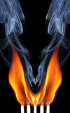 Match with fire and smoke. Royalty Free Stock Image