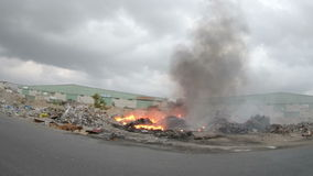 Fire and smoke with burning garbage in cloudy day Royalty Free Stock Photo