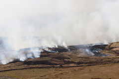 Fire and smoke on burning moorland vegetation. Stock Photo