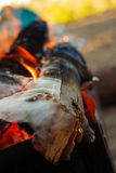 Fire smoke coming out of the wood log Stock Photography