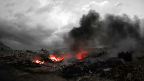 Fire and smoke over burning garbage in Monochrome Stock Image