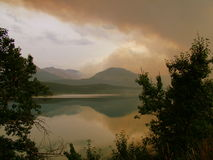 Fire Smoke Over St Maty Lake Royalty Free Stock Photos