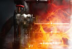 Fire, smoke and steam in a boiler room. Copper pipes and valves on a wet boiler. Close up stock photos