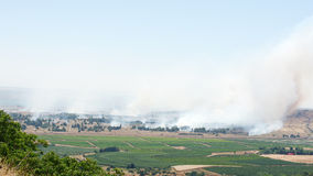 Fire and smoke - war in Syria near Israeli border Stock Photos