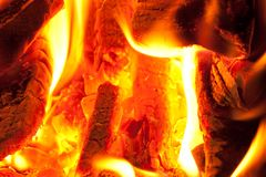 Fire smoldering charcoal. Warm wood Royalty Free Stock Photography