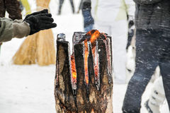 Fire in Snow. Need to warm up your hands Royalty Free Stock Photos