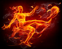 Fire soccer player. Fiery football player with a fire ball Royalty Free Stock Images