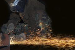 Fire space. An arc welder spraying a lot of fire royalty free stock images