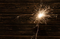 Fire spark xmas with wood background Stock Photos