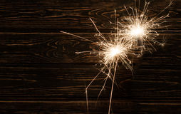 Fire spark xmas with wood background Stock Image