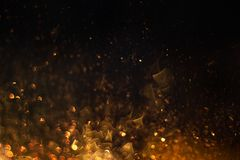 Fire sparkles glowing in darkness stock images