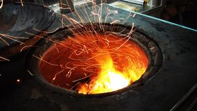 Fire sparkles from Live Oven. Flares sparkling from a live oven. Also used in iron manufacturing factory Stock Photo