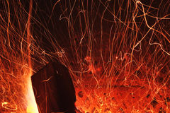 Fire sparkles with log wood. In chimney stock images