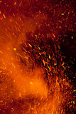 Fire Sparks. Flying in an abstract pattern due to wind Royalty Free Stock Photography