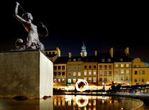 Fire Spinner In Old Town Warsaw Reflecting off Fountain stock photography